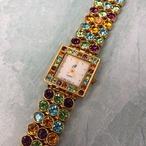 Suzanne Somers multi color stone with gold watch